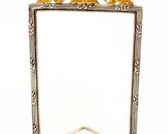 Silver photo frame with volute