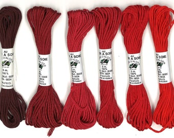 Pack of six skeins of yard long red
