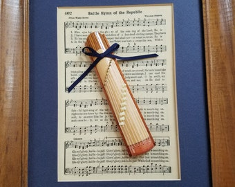 Framed picture of sheet music with a miniature Japanese zither framed sheet music, miniture zither, asian-inspired instrument