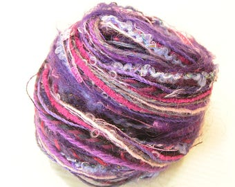 Yarn Hank with a variety of purple yarns