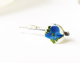 Pressed flower tie clip , blue hydrangea with ferns on white epixy clay, filled with resin