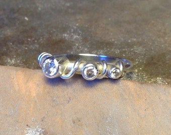 Handmade ring made in recycled sterling silver with 3x lab grown cubic zirconium.