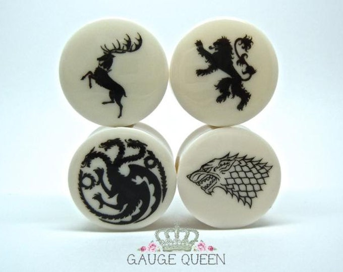 "Game Of Thrones Plugs/Gauges. 4g /5mm, 2g /6.5mm, 0g /8mm, 00g /10mm, 1/2"" /12.5mm, 9/16"" /14mm, 5/8"" /16mm, 3/4"" /19mm, 7/8""/22mm, 1"" /25mm"