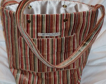 The Jeff Field Bag in striped velvet upholstery fabric in cream, pinks, and greens with a cream poly charmeuse lining