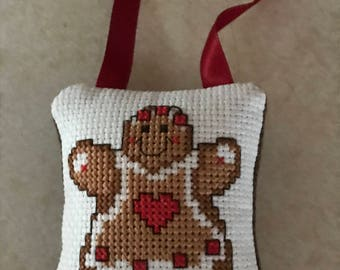 Gingerbread girl with heart ornament