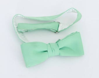 Vintage (70's/80's) pale green polyester clip-on bow tie, unlabeled
