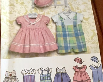 Simplicity 4711 | Babies Dress Rompers and Hat Pattern | size xxsmall to large | uncut