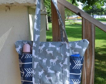 Handmade zip top diaper bag made with grey deer sillohette and navy arrow fabric
