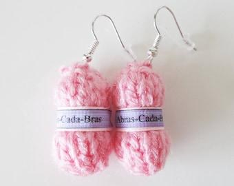 Earrings in the shape of pink yarn