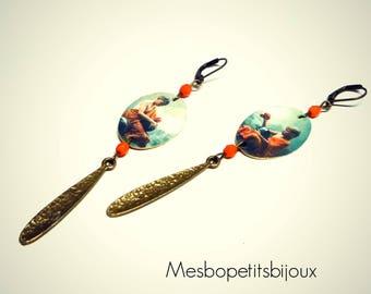Oval earrings, single piece, Buddhist