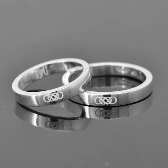 Double infinity ring infinity ring for men sterling silver for Wedding ring tattoos cost