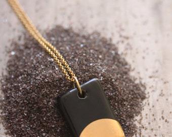 Gold Luster Pendant Necklace in Black