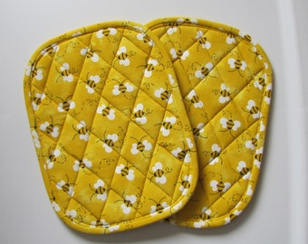 "Bees, honey bees, bumble bees 7x9"" oval potholders - set of 2"