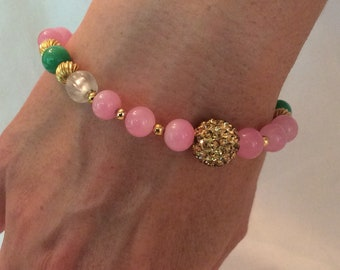 Pink jade bracelet with green, gold and crystal accent beads