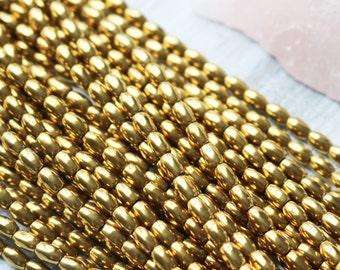 gold hematite beads, rice shape beads, 4mmx 6mm, gemstone beads, gold beads, full stand, tiny beads,