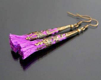 Purple tassel earrings.