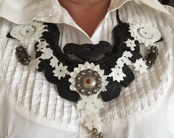 Tribal necklace with fabric lace of traditional Dutch costume