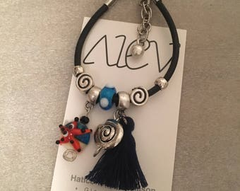 Nautical, leather and tassel charm bracelet with flameworked glass beads