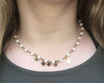 simple gold star center necklace