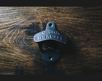 Vintage Style Wall Mounted Bottle Opener in an Antique Iron Finish (Drink Real Ale)