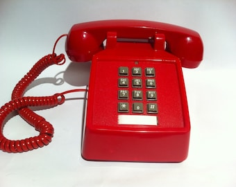 Vintage cherry red push button phone.  Retro telephone.