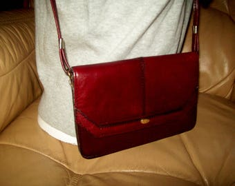 A vintage small real leather cross body / messenger bag