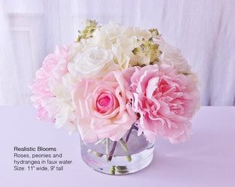 Cream, pink, silk, rose/roses, peony/peonies, hydrangea, faux water, acrylic/illusion, Real Touch flowers, floral arrangement, centerpiece