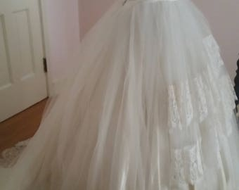 Vintage wedding dress.  Chantilly lace and tulle ballgown skirt.  In good condition from 50's era with a slight train.  Small.
