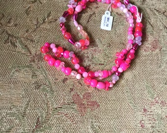 Multi colored pink necklace.