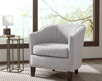 Designed for stylish comfort and the efficiency to best utilize space, this shaped barrel armchair maximizes sitting space for any room.
