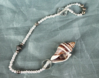 Shell Rose and Glass Pendulum