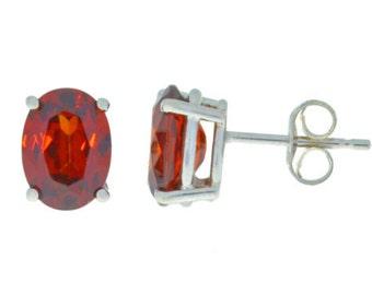 14Kt White Gold Garnet Oval Stud Earrings