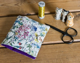 This sewing case is hand stitched in a Liberty Tana Lawn floral print called 'Wild Flowers', partnered  with crisp purple cotton