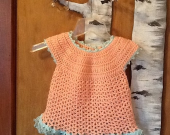 Crocheted melon colored dress with variegated sea foam trim for 6-12 months