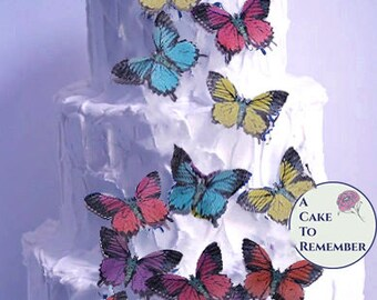 15 large edible butterflies in assorted colros for cake decorating. Wafer paper butterflies, wedding cake toppers, cupcake decorations