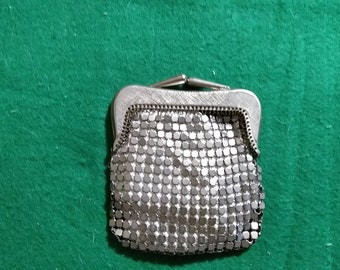 Small silver tile change purse.