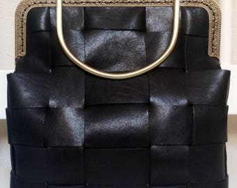 Woven leather bag with metal closure