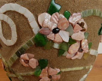 Mosaic plant pot, beads, marble, sand and stones forming flowers