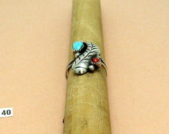 Turquoise & Coral in a Sterling Silver ring decorated with S. S. feather and beads. Size 6 1/4