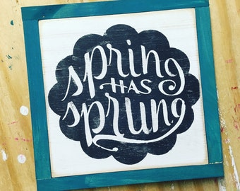 Spring has sprung rustic sign