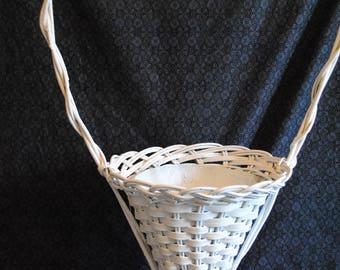 Tall white wicker basket planter