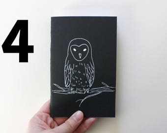 Notebook Pocket design black owls and owls, approximately A6. Black cover drawn by hand. Hand assembled.