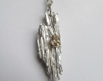 Silver broom cast pendant with faceted citrine