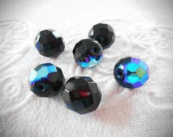 Six 12 mm faceted black Czech glass beads.