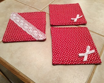 Hot pan holders made out of red and white material
