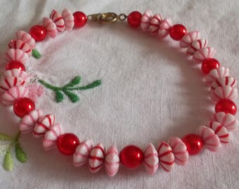 Bracelet red beads and flower beads