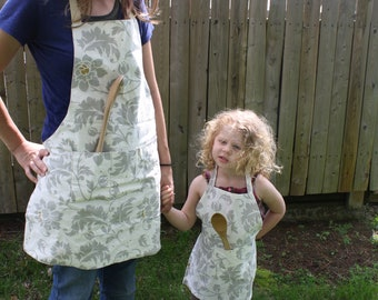 Mommy and me matching gray and cream aprons