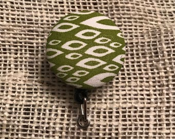 Fabric button retractable badge reel!
