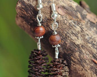 Pine cones, wooden beads and silver-plated earrings