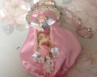 Victorian clasp purse with beaded handle with image of Victorian lady